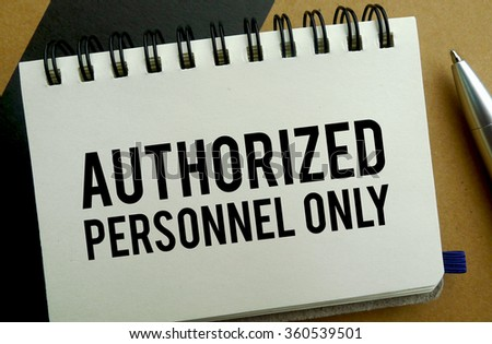 Authorized personnel only memo written on a notebook with pen