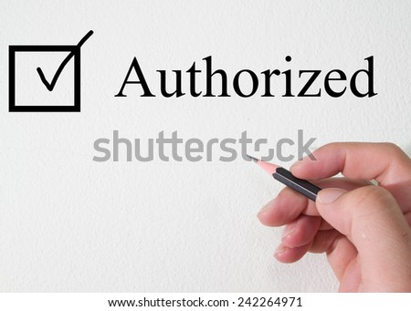 authorized text concept on torn paper - stock photo