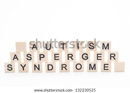 Autism asperger syndrome spelled out in plastic letter pieces on white background - stock photo