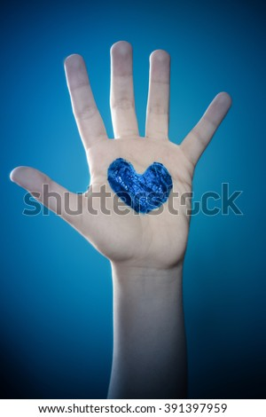 Autism Awarness Picture _ Blue Heart with Stop Hand Sign_ Autism isn't a tragedy , Ignorance is  - stock photo