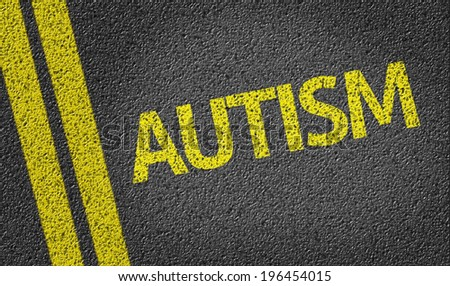 Autism written on the road - stock photo