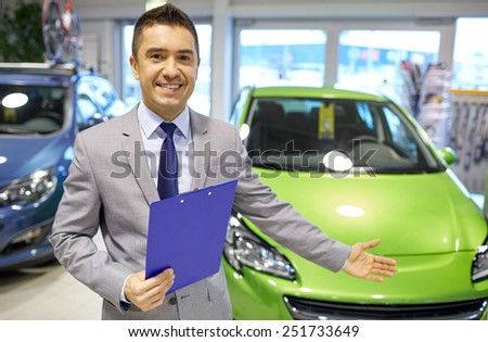 auto business, car sale, consumerism and people concept - happy man at auto show or salon - stock photo