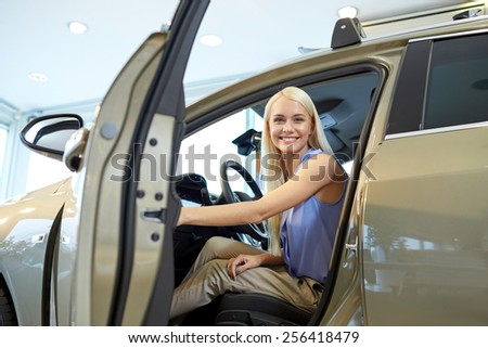 auto business, car sale, consumerism , transportation and people concept - happy woman sitting in or driving car - stock photo