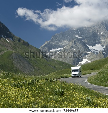 Auto-camper on the move, motorhome on holiday - stock photo