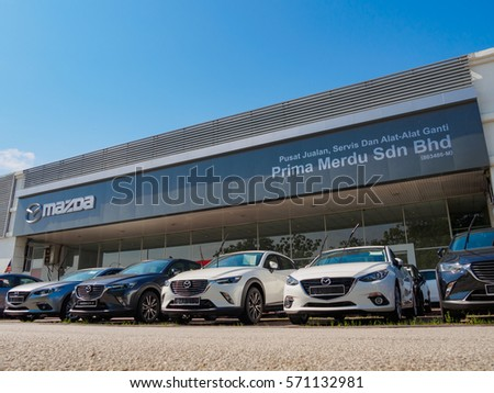 Auto City, Penang, Malaysia - January 29, 2017: Mazda showroom and Office of official dealer. Mazda Motor Corporation is a Japanese automaker based in Fuch , Aki District, Hiroshima Prefecture, Japan.
