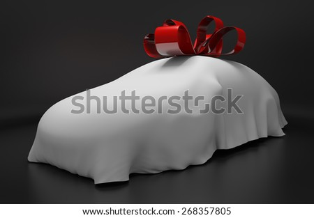 Auto concept of a new covered sports car topped with a red ribbon as a gift - stock photo