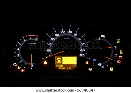 Auto indicator board - closeup of car dashboard - stock photo