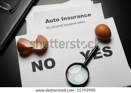 Auto insurance concept comparison with whole and broken eggs - stock photo