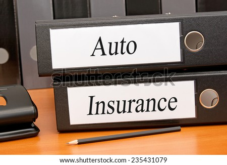 Auto Insurance - two binders in the office - stock photo