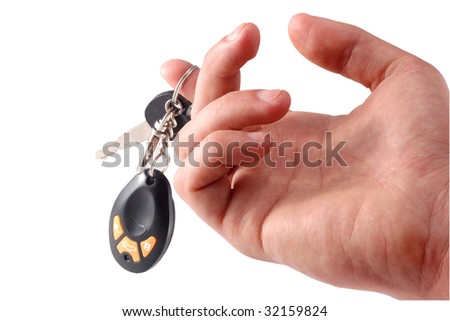 auto keys in a hand on a white background