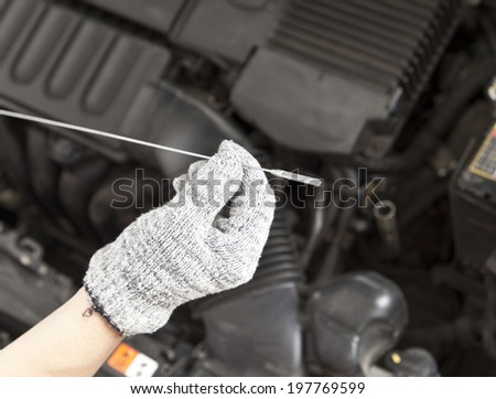 Auto mechanic checking oil , diy - stock photo