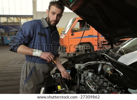 auto mechanic checking oil engine - stock photo