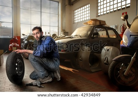auto mechanic in a workshop - stock photo