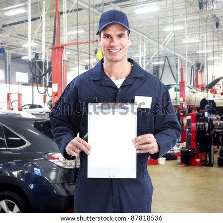 Auto mechanic in auto repair shop. Garage. - stock photo