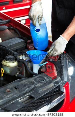 Auto mechanic in auto repair shop. Garage. - stock photo