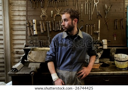 auto mechanic in his workshop - stock photo