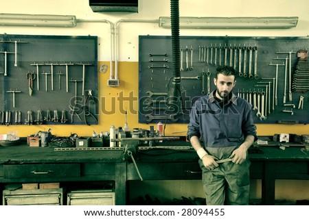 auto mechanic in his workshop - stock photo