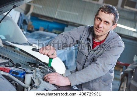 auto mechanic repair car in garage