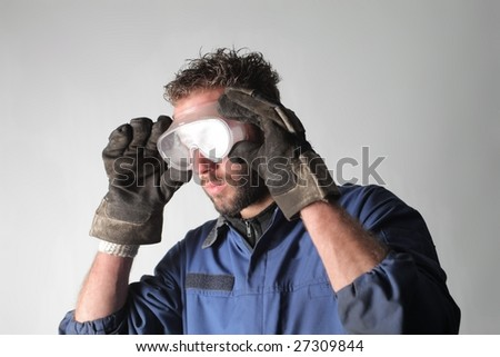 auto mechanic wearing protection equipment - stock photo