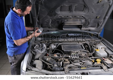 Auto mechanic working on car - a series of MECHANIC related images. - stock photo