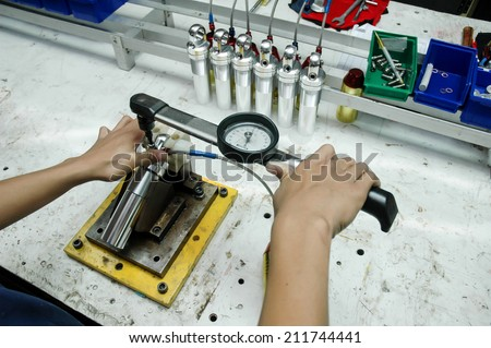 Auto mechanical engineer adjusting a car shock absorber in car service workshop,Hand man repair motorcycle during day,Motorcycle mechanic,Technician - stock photo