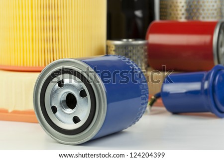 Auto oil filter on a various filter background - stock photo