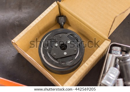 Auto parts of the car in garage wait for repair - stock photo