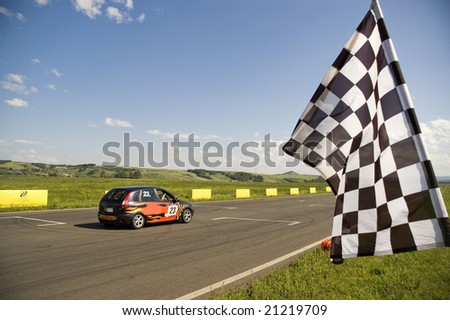 Auto racing checkered flag on a background of the  blue sky. - stock photo