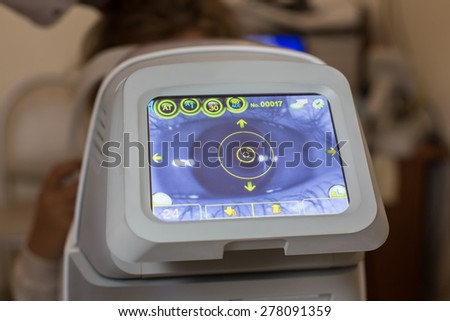 Auto-Ref-Keratometer display with an eye on it - stock photo