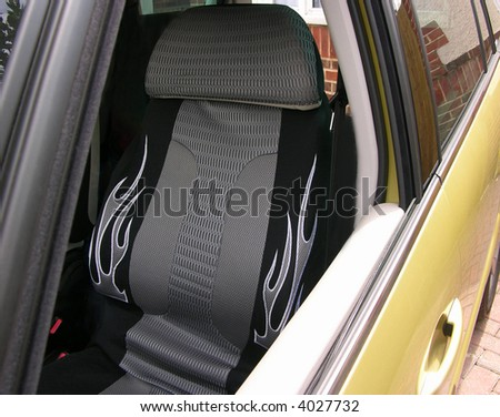 Auto seat and seat belt in modern sports car - stock photo