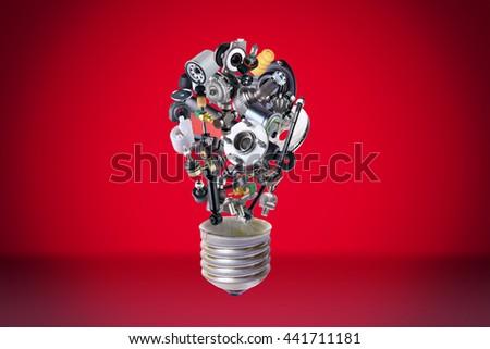 Auto spare parts items in bulb idea. New original equipment spare parts make bulb idea. Many auto spare parts. OEM spare parts in bulb. Auto parts like idea. - stock photo
