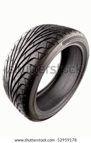 Auto tyre isolated on plain background - stock photo