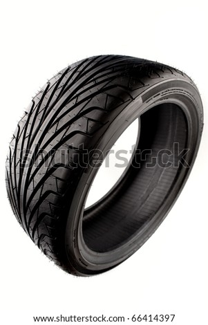 Auto tyre isolated on plain background - stock photo