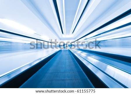 auto walkway moving on at shanghai airport. - stock photo