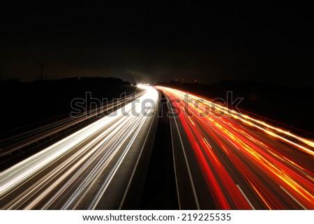 Autobahn bei Nacht - Freeway at night - stock photo
