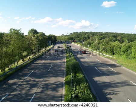 autobahn, highway landscape - cars on  highway, clouds and the blue sky - stock photo