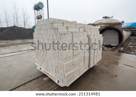 autoclaved aerated concrete block in a building materials plant - stock photo