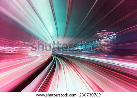 Automated guide-way train at night in Japan - stock photo