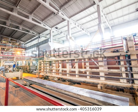 automated industrial equipment at the factory in  production hall