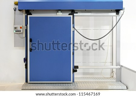 Automated insulated blue door at reefer refrigerator - stock photo