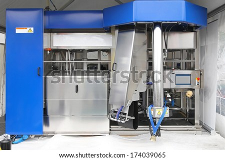 Automated milking station dairy equipment at modern farm - stock photo