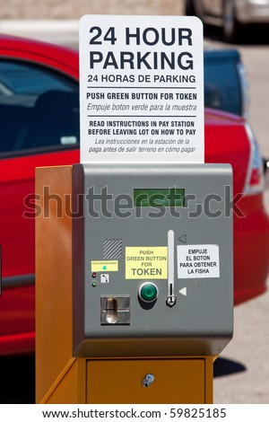 Automated parking meter in urban parking lot - stock photo