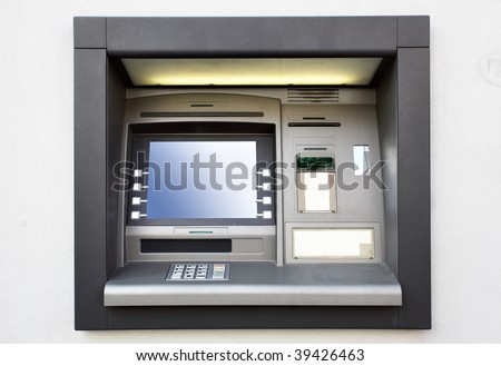Automated teller machine close up on a wall - stock photo