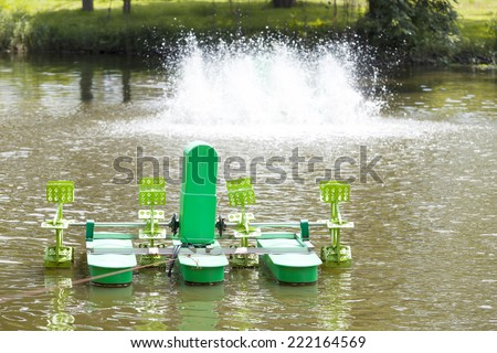 Automatic Aerator floated on water surface, oxygen blenders, water treatment - stock photo