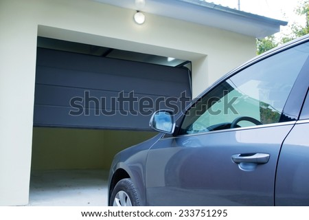 Automatic and convenient   garage doors opening for a car - stock photo