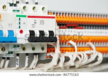 stock photo automatic electrical fuseboxes and power lines located inside of an industrial switch control panel 86775163 distribution board stock images, royalty free images & vectors Circuit Breaker Box at readyjetset.co