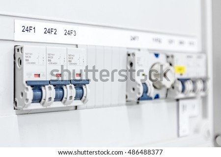 stock photo automatic fuse electrical connector in power lines located inside of switch control panel board 486488377 automatic fuse electrical connector power lines stock photo Circuit Breaker Box at readyjetset.co