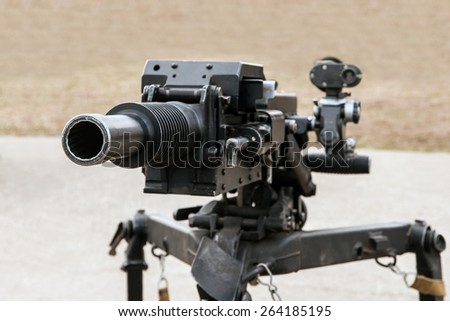 automatic grenade launcher on fighting position - stock photo