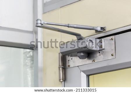 automatic hydraulic leaver hinge door - stock photo