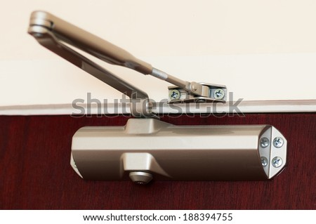 Automatic hydraulic leaver hinge door closer holder  - stock photo